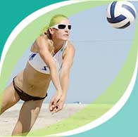 Woman playing beach vollyball